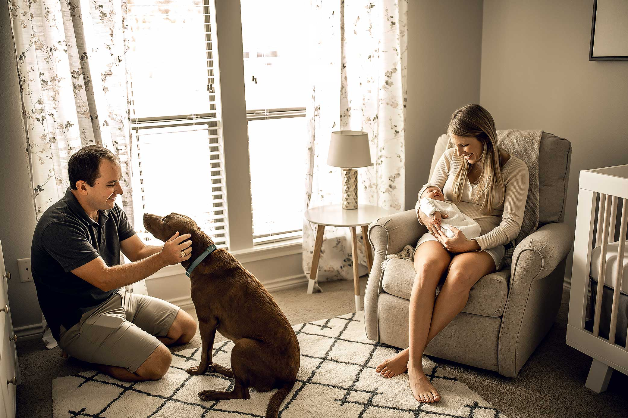 shelby-schiller-photography-reviews-at-home-lifestyle-newborn-with-dog-in-nursery.jpg