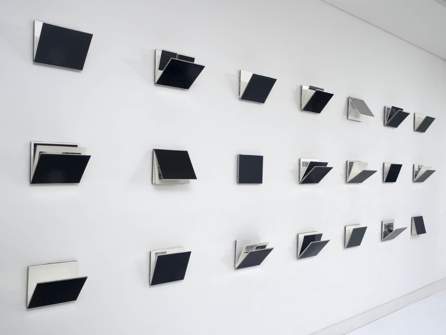 Fernanda Fragateiro  Measuring E1027 , 2011 21 handmade books, silk cover and acrylic, 150 x 25 x 550 cm