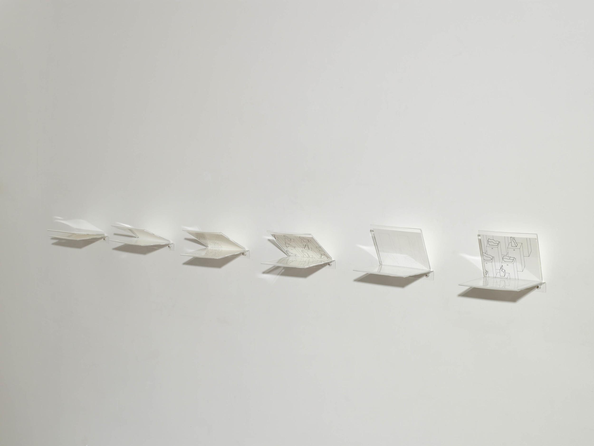 "Fernanda Fragateiro  Utopien , 2009 kursbuch n52 with insert of: Enzo Mari, ""44 Evaluations"" 1976 for the Venice Bienal; 6 acrylic pieces, 23 x 33,5 x 16 cm (each), book 18.5 x 12.5 x 2.5 cm, variable dimension"