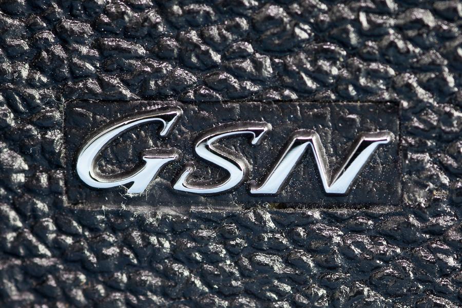 The GSN has a chrome covered body, whereas the similar GTN has a black body