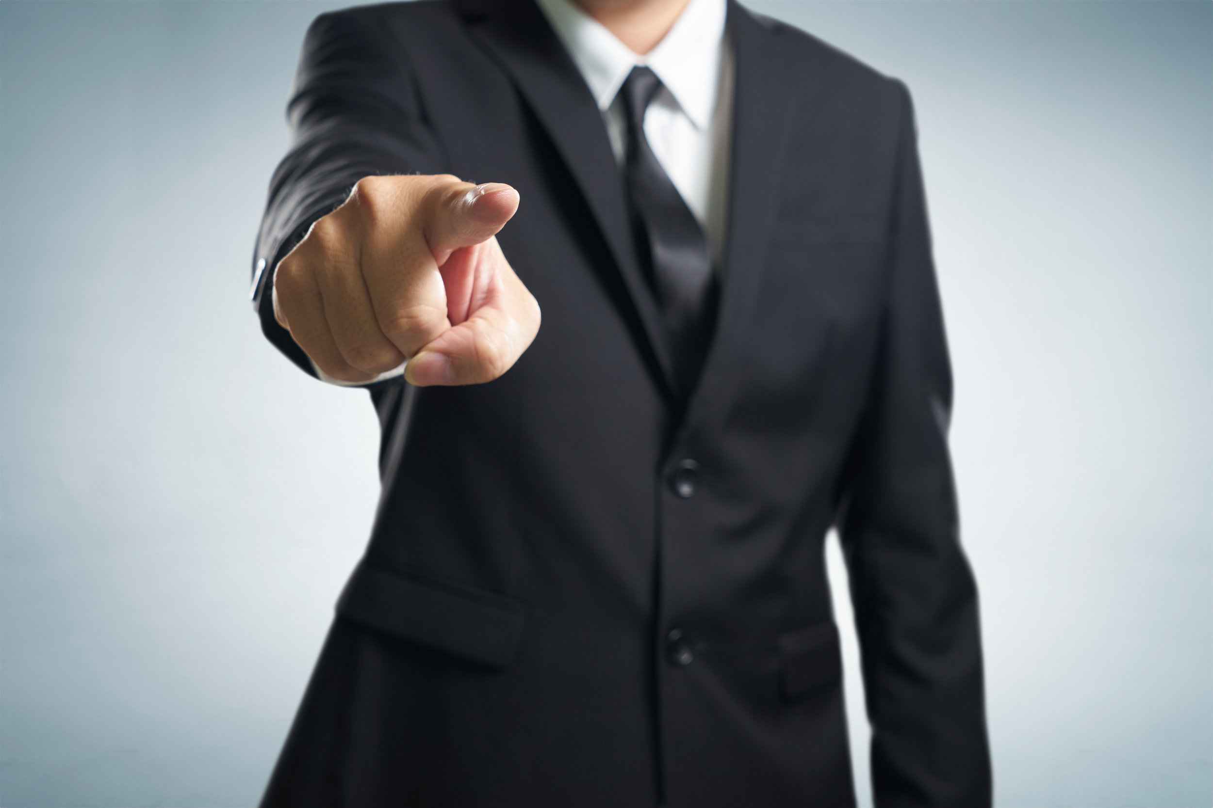 graphicstock-business-man-points-his-finger-at-you-focus-on-hand-blur-out-the-suit_rd0n7nDesl.jpg