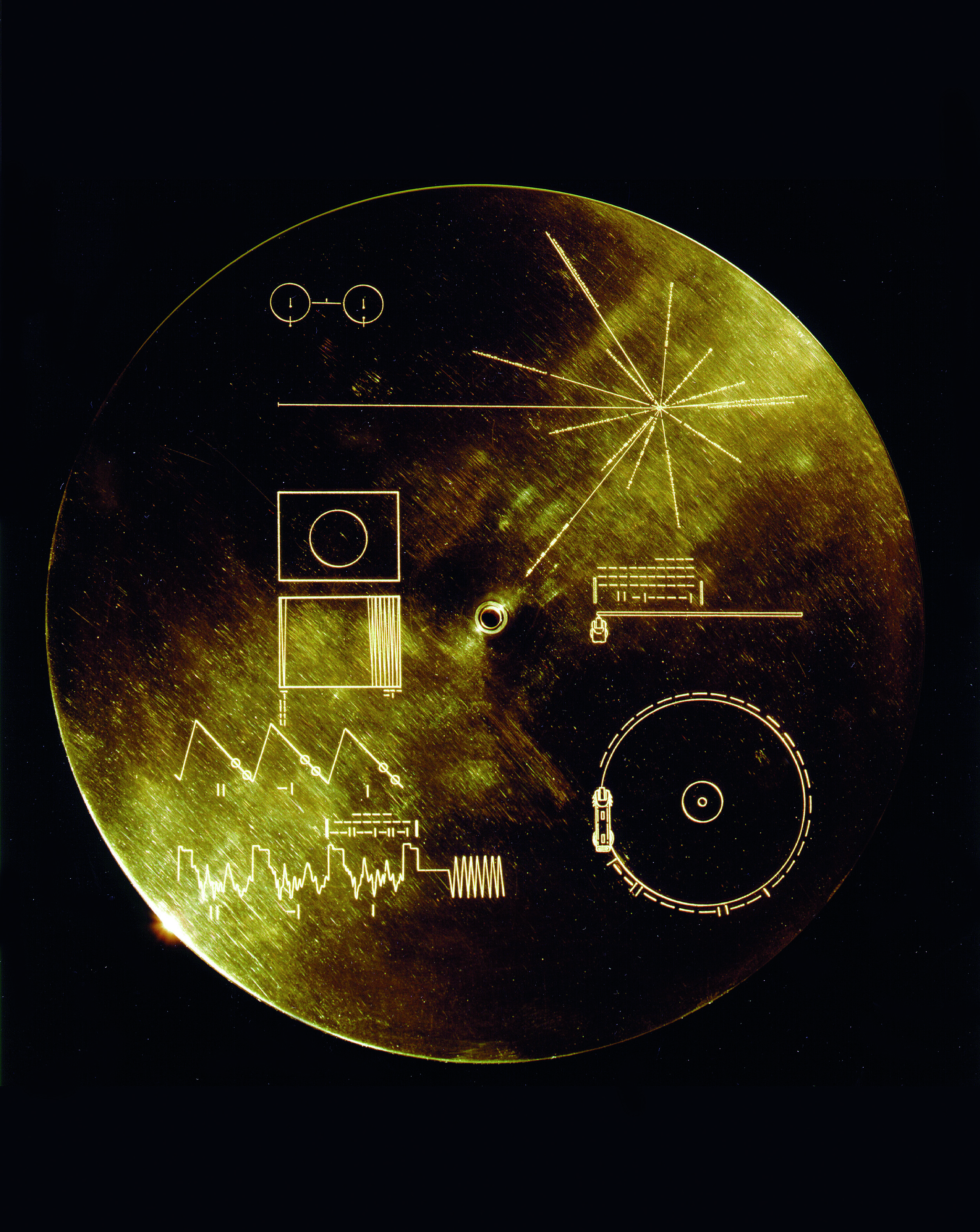 Press play: A gold aluminium cover designed to protect the Sounds of Earth's gold-plated records from micrometeorite bombardment during its epic, interstellar journey, also featured playing instructions to any alien who found the record. Photo courtesy NASA.