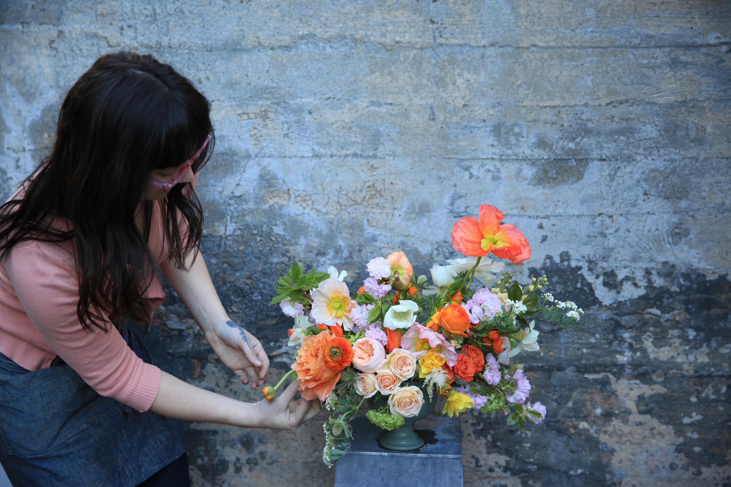 caitlin with poppy arrangement.jpg