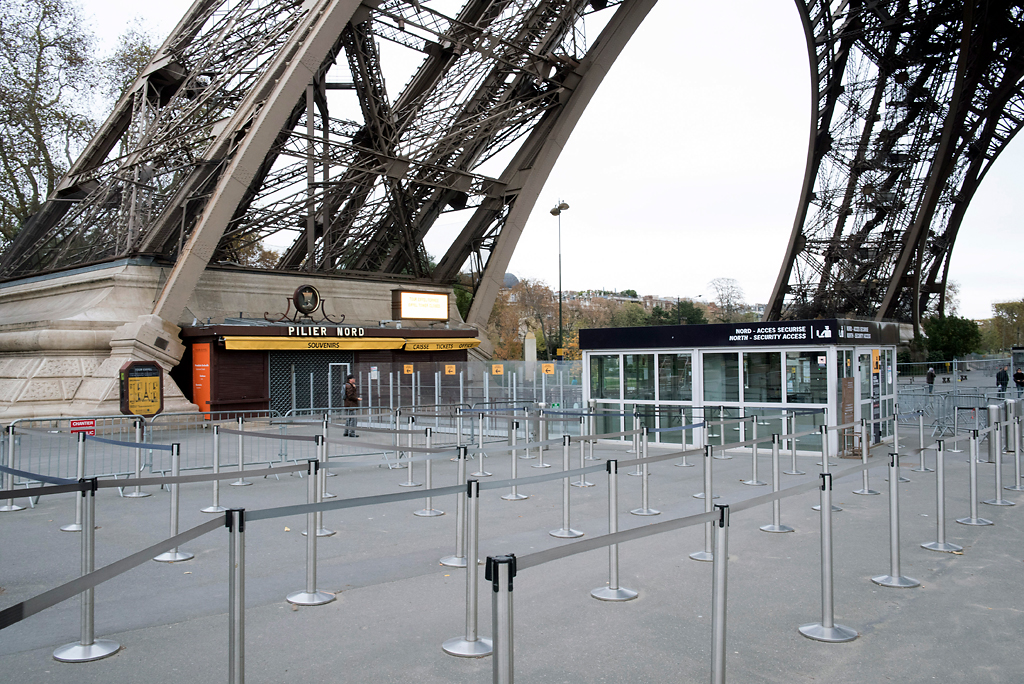 No queues, closed ticket offices and souvenirs shops are seen at the Eiffel Tower in Paris, France, Saturday, Nov. 14, 2015. French President Francois Hollande vowed to attack the Islamic State group without mercy as the jihadist group claimed responsibility Saturday for orchestrating the deadliest attacks on France since World War II.  Photo by Kamil Zihnioglu/AP