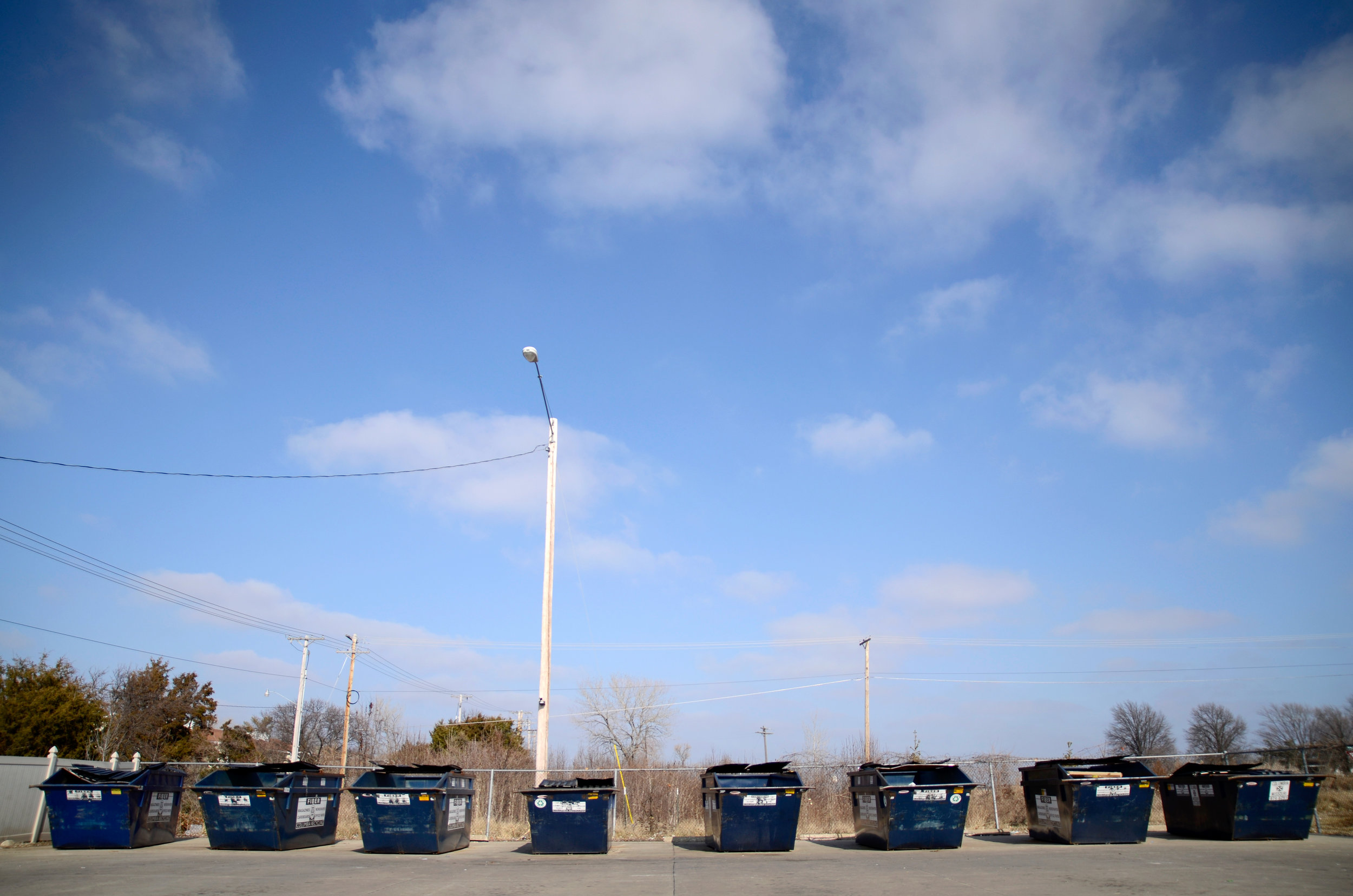 Eight recycle bins line the edge of the recycling drop-off location on State Farm Parkway in Columbia, MO, on Friday, Jan. 23, 2015. These bins accept the same recyclable items that can be placed curbside, but plastic bags are not allowed in these containers.
