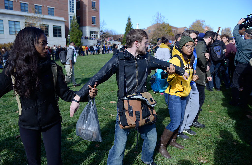 People form a human chain trying to keep media out after Jonathan Butler's hunger strike was brought to an end Monday morning as UM System President Tim Wolfe officially resigned Nov. 9, 2015.  Photo by Justin L. Stewart/Missourian