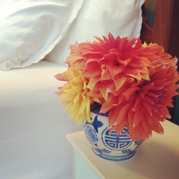 Dahlias adorn the Blue Spruce Room bedside table.
