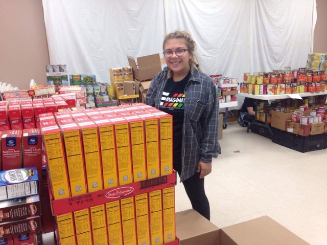 Haley Nethery helping sort and place food at Trinity Lutheran for Food Pantry 279