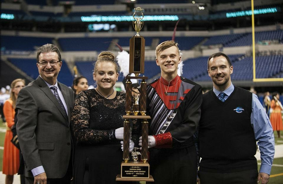 Our Kelsey and Ben are seen here recieving our trophy at Lucas Oil after an amazing state run!