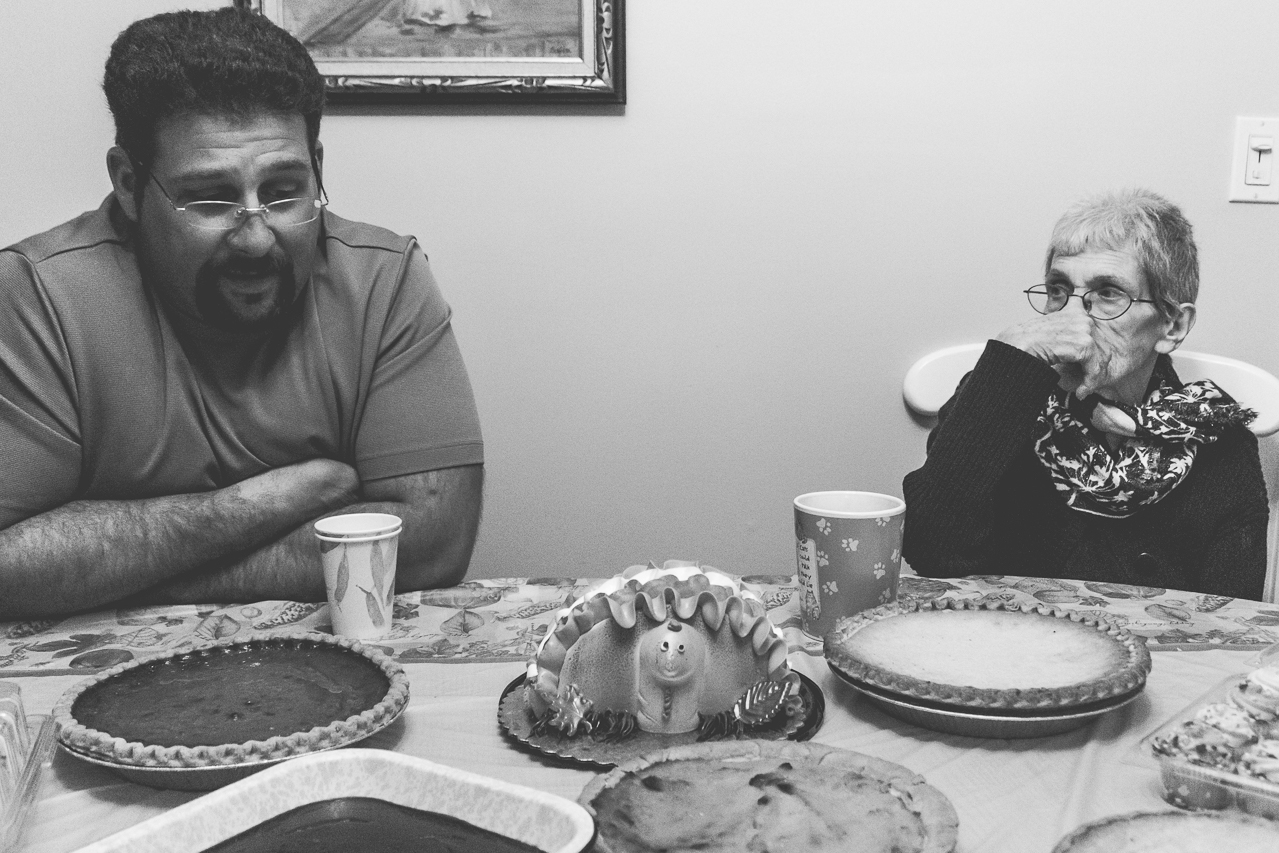 New Jersey Family Photographer - black and white photo of a man and elderly woman at dinner table