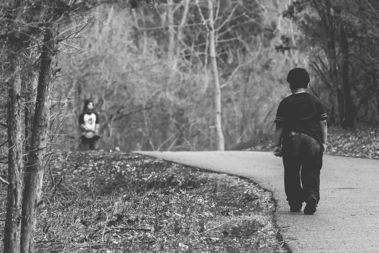 New Jersey Family Photographer - sibling photography - black and white photo of an unhappy boy on a hike