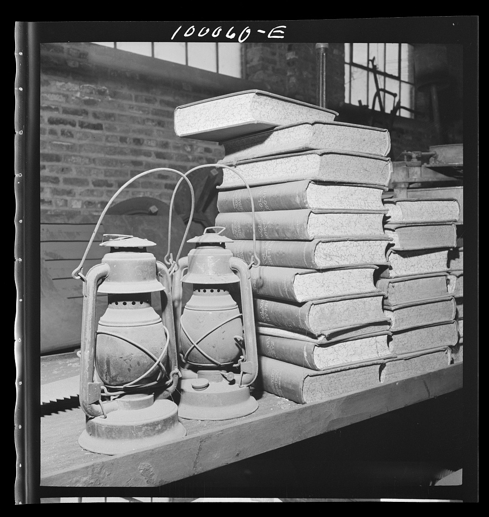 Collins, Marjory, photographer. Washington, D.C. Salvage drive, Victory Program. Books and old lantern stored in District wholesale junk company warehouse. Washington D.C, 1942. May. Photograph. Retrieved from the Library of Congress, https://www.loc.gov/item/fsa2000056548/PP/. (Accessed November 27, 2017.)
