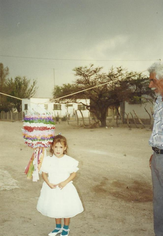 A 6 year old me, being watched over by my favorite person, my grandfather Alejandro.