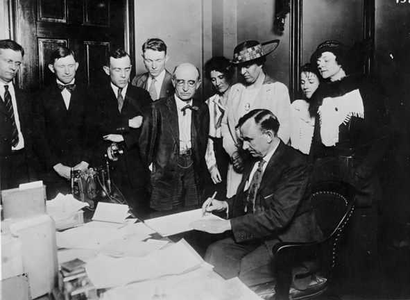 Governor Albert Roberts (seated) at the Tennessee ratification ceremony for the 19th Amendment