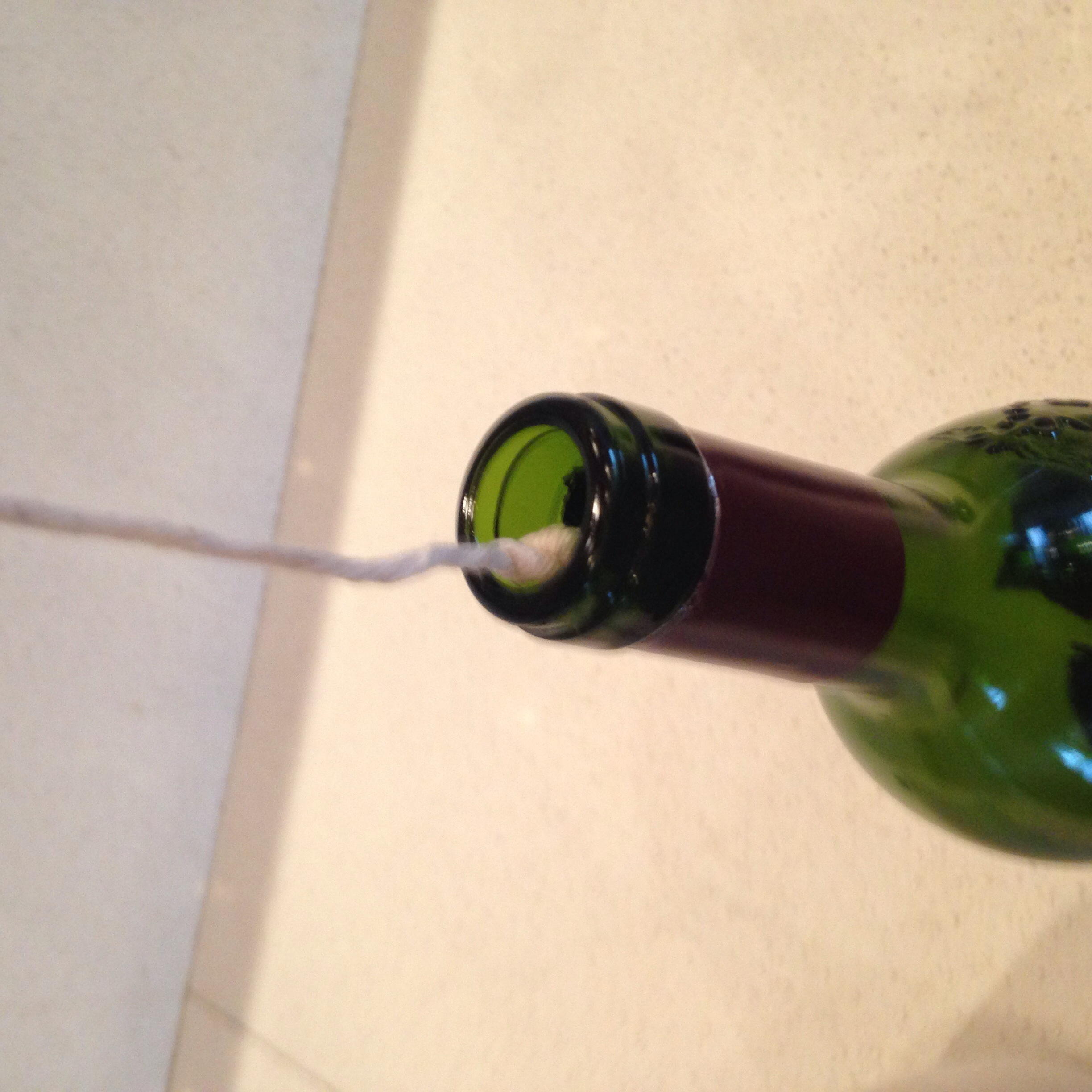 Step 4: Insert twine, knot-side first into the bottle.