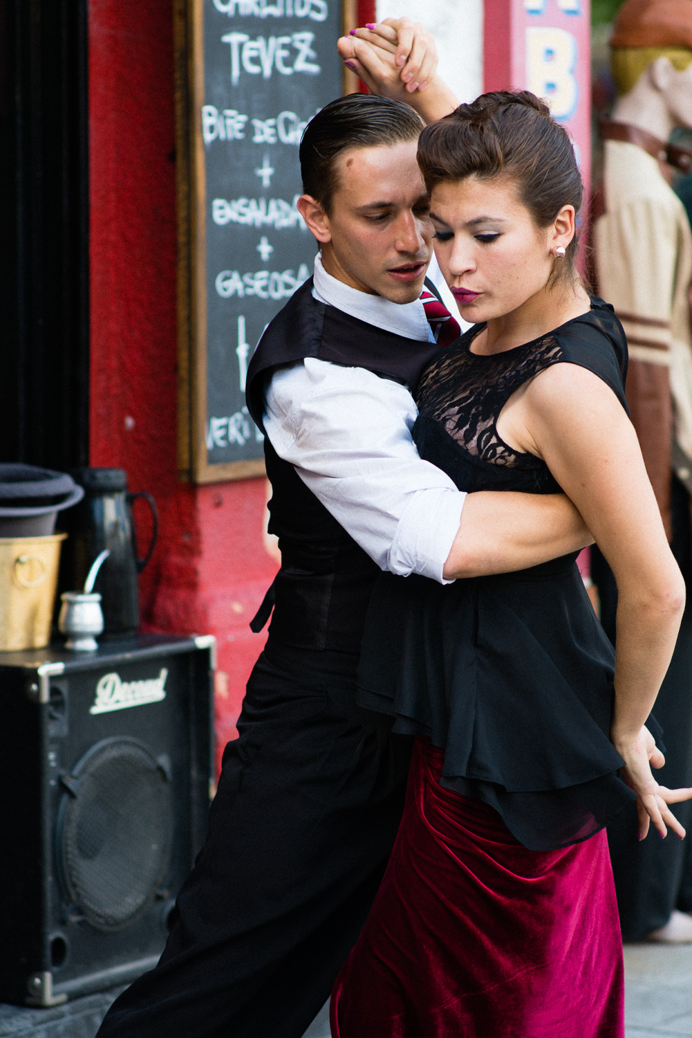 Street tango in La Boca. Note the ubiquitous mate gourd in the background.