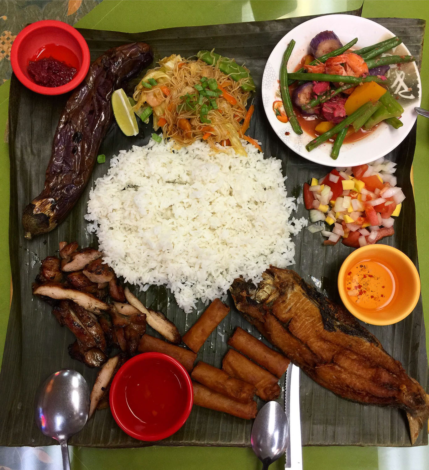 Ihawan's banana leaf feast for two.Pork BBQ, milkfish, grilled eggplant, shanghai noodles, spring rolls and more. Grab a handful and shove it in your face!