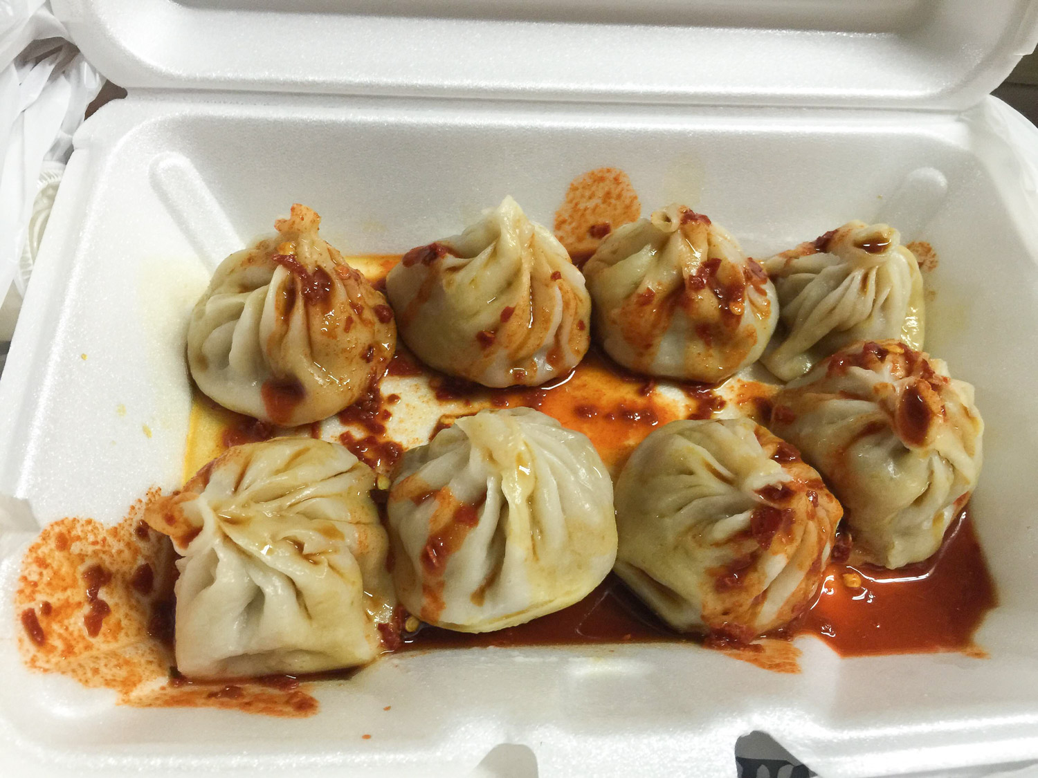 Tibetan momo's smothered in a mix of black vinegar, soy and chili sauce. $5, unbelievable.