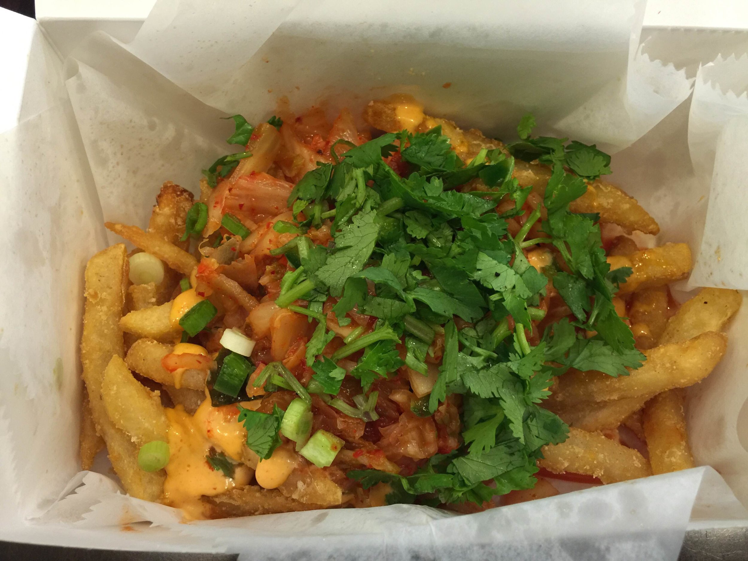 JoJu's Loaded Kimchi Fries. They also do Loaded Banh Mi Fries which are the ingredients of a Banh Mi dumped all over french fries. Disgustingly awesome.