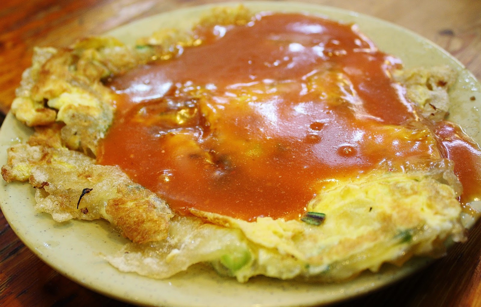 "Famous Taiwanese oyster omelete aka ""oyster pancake"" Made with potato starch and really chewy and delicious. Google Images."