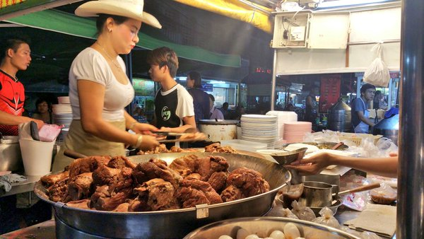 "The ""Cowboy Lady"" made famous by Anthony Bourdain, hard at work on her pork magic in Chiang Mai, Thailand. Google Images."