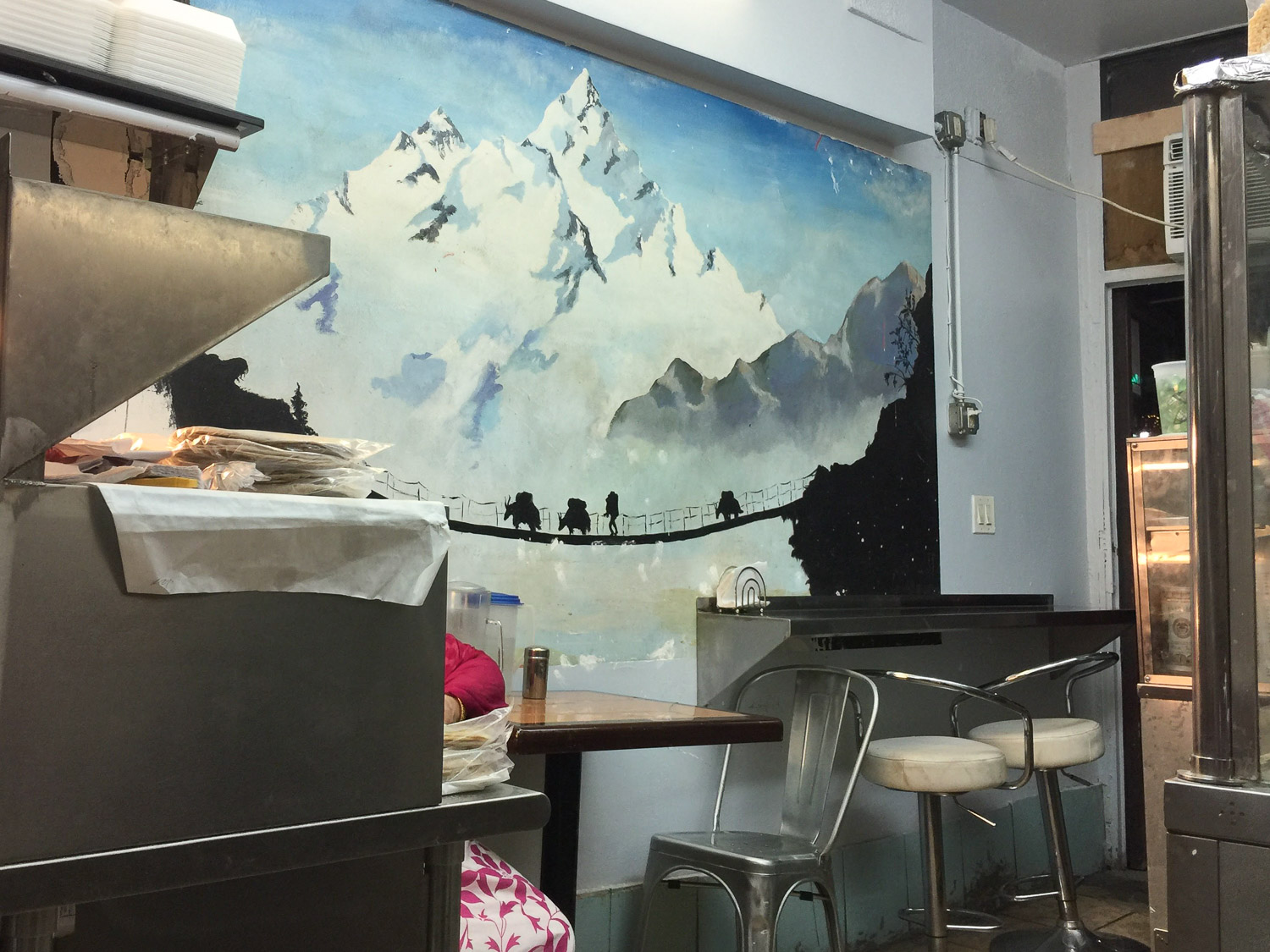 Tawa Roti's kitchen and dining room is one long corridor-like space. I love the Himalayan mural.