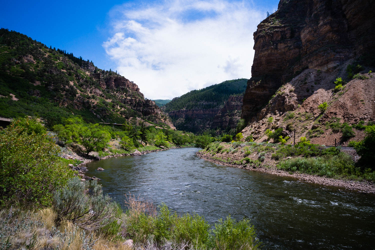 The Colorado River running through Glenwood Canyon. It splits off into the Rio Grande in Glenwood Springs where you can pick up another bike path that takes you all the way down to Aspen. This part of the country is an outdoor lover's paradise.