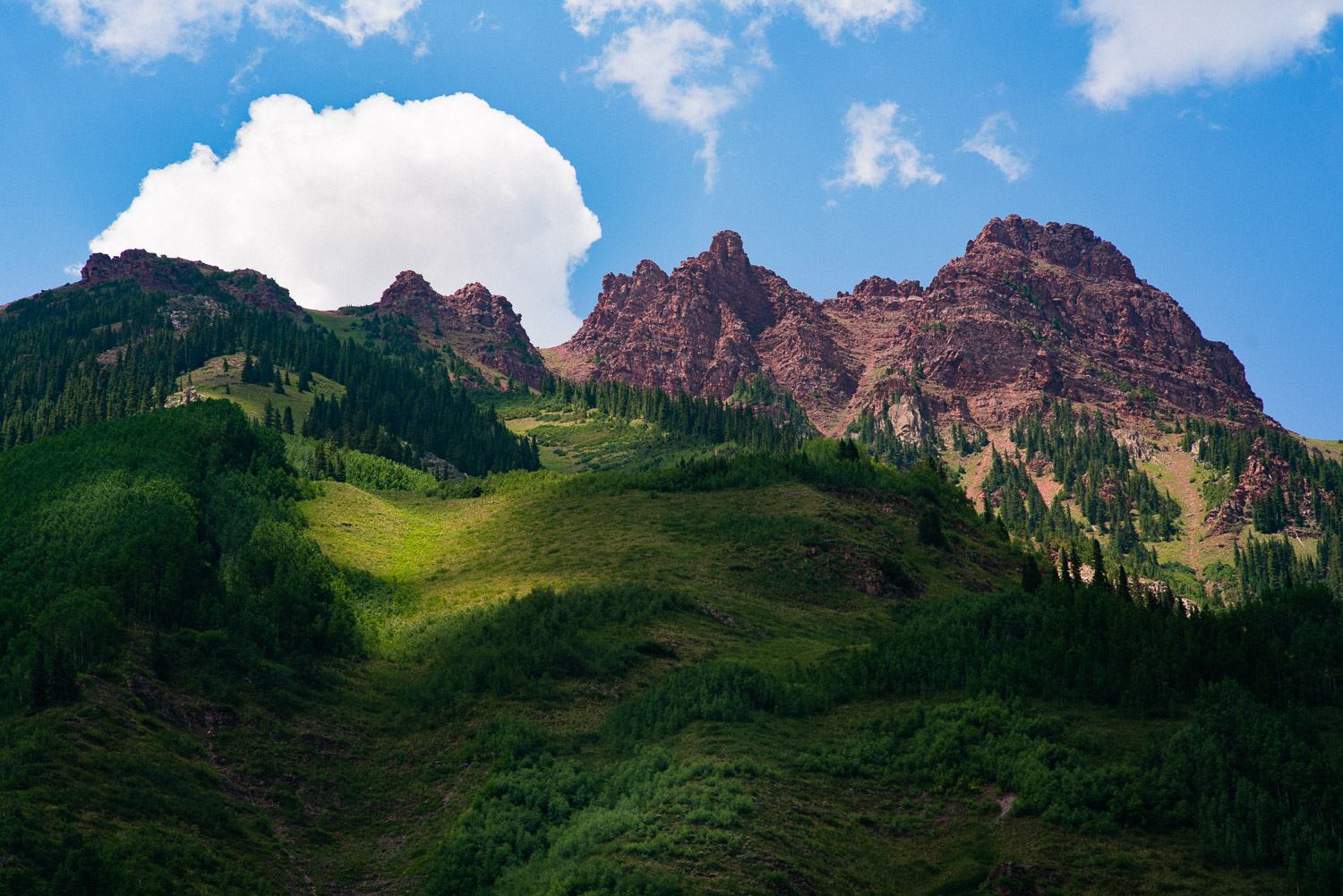Trippy geography around the Maroon Bells. At this elevation the clouds appear to move much faster than usual, if you just sit and stare at the changing light on the mountains, it's as satisfying as your favorite movie.