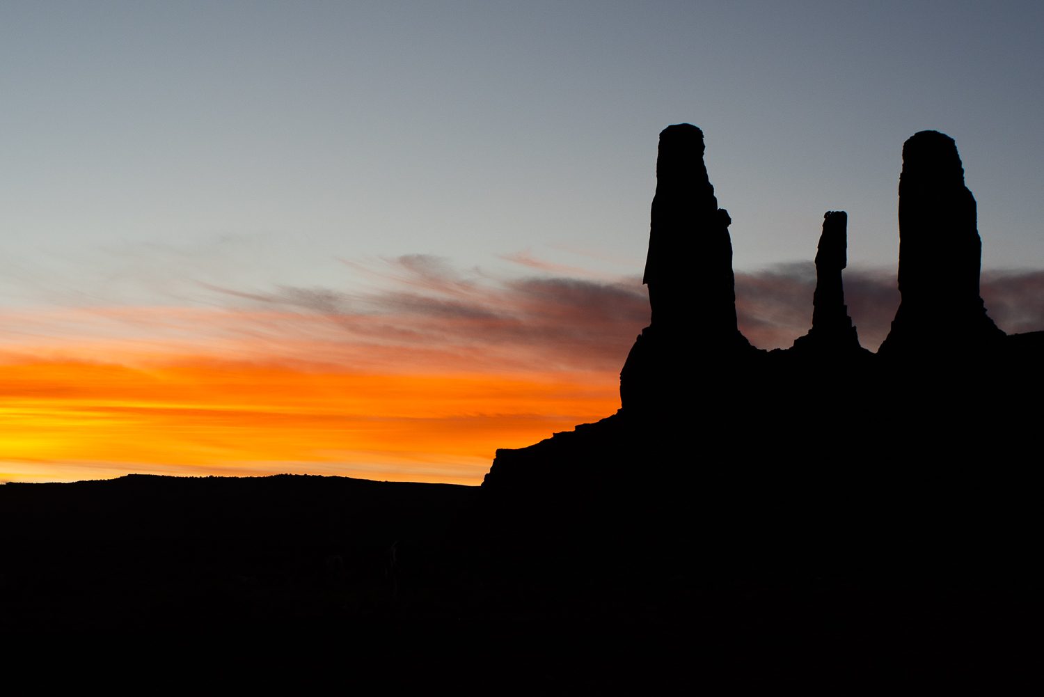 The sun sets behind the Three Sisters.