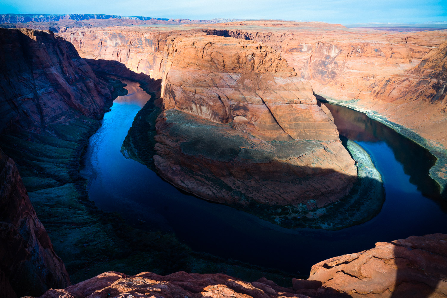 Horseshoe Bend. If you get vertigo easily, stay away from the edge because it's a long drop down and every year at least of handful of poor souls lose their footing and that's the end of them. If you want the best shots here it's actually mid day to avoid half the feature being emerged in shadow, sunset, or long exposures in the middle of the night.