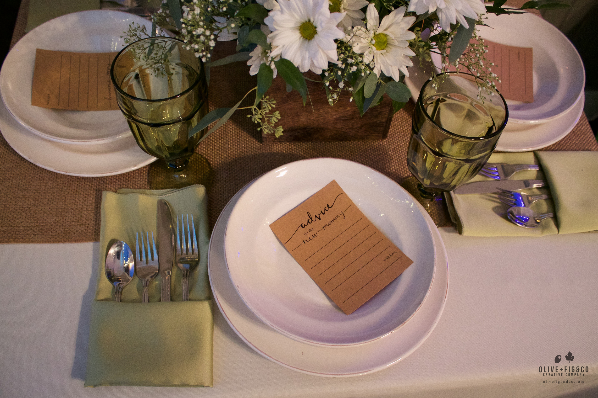 "Baby Shower Table: ""Advice for the New Mommy"" cards designed by O+F."