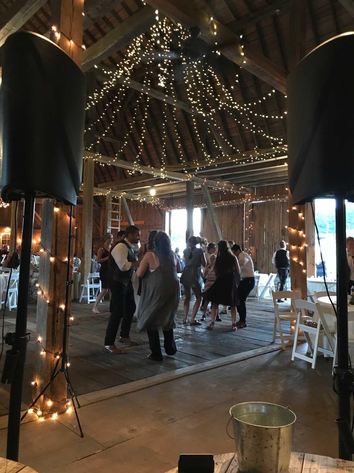Norman Networking - People Dancing at Barn Wedding