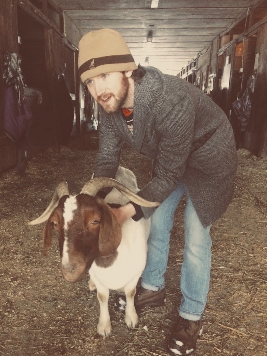Meir with Zeus, the goat, at  Catskill Animal Sanctuary