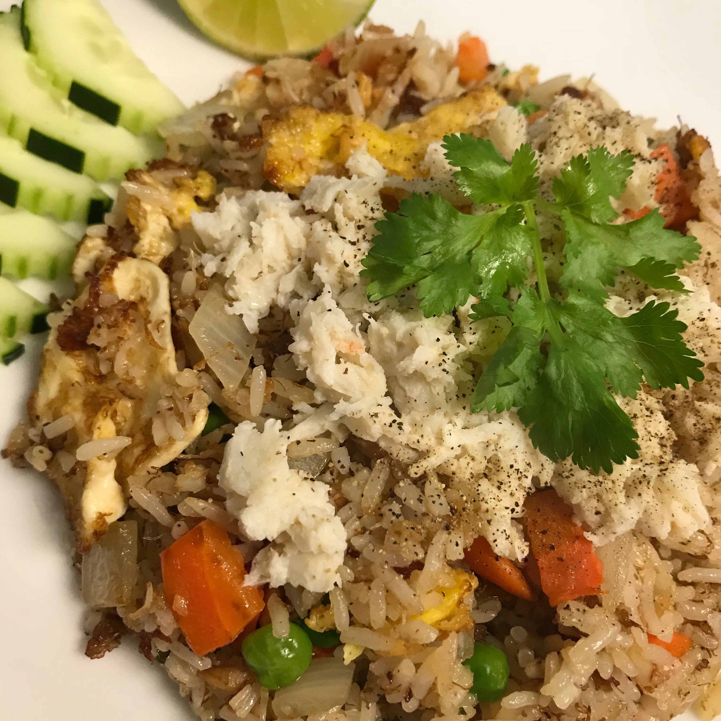crab cake stir fried in with rice, sweet peas, carrots, onions, and egg | topped with crab meat