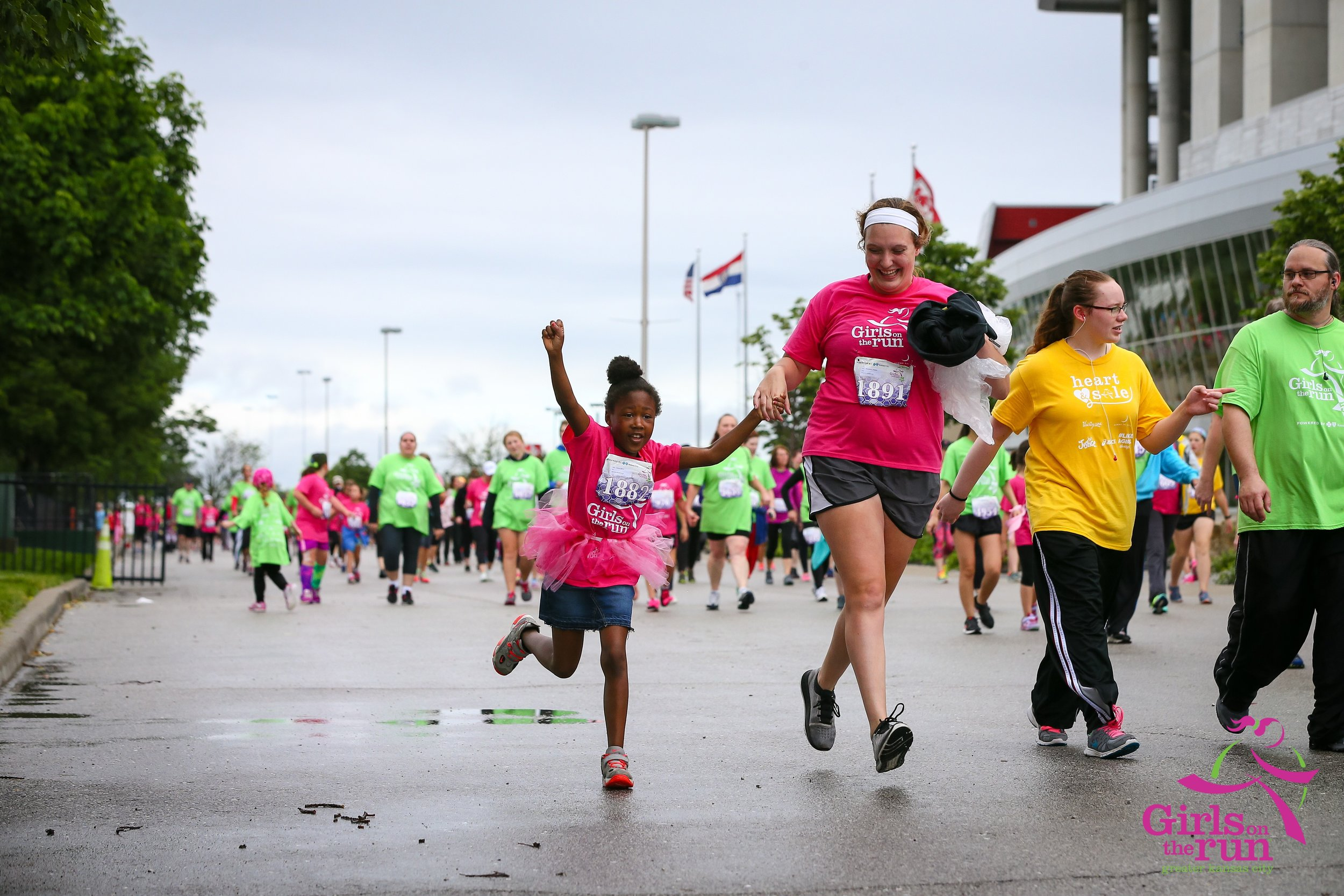 """Lis and Zi'yerra """"Zippy"""" near the finish line at a Girls on the Run race."""