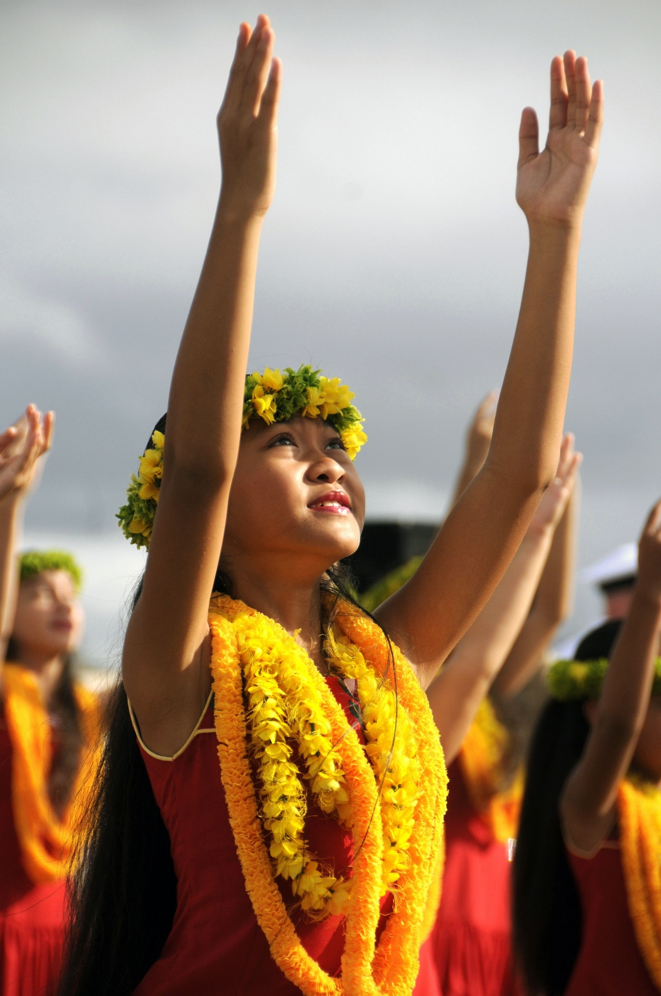 A Hawaiian girl wearing a traditional lei