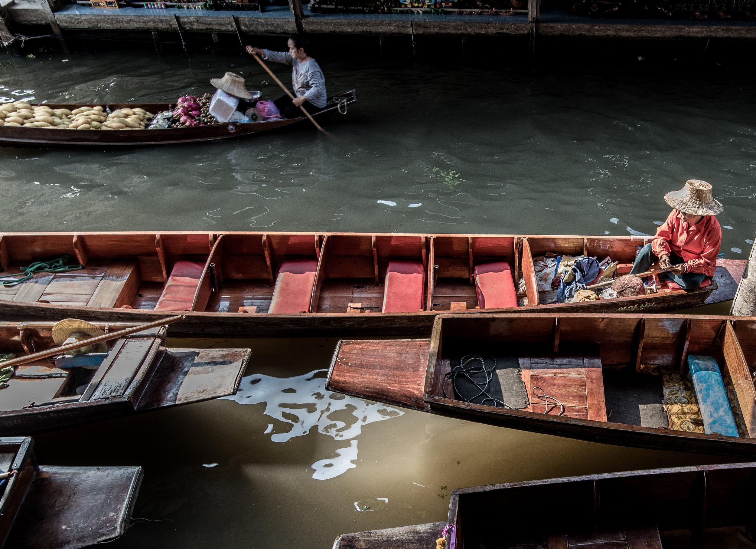 Floating Market Man in empty boat.jpg