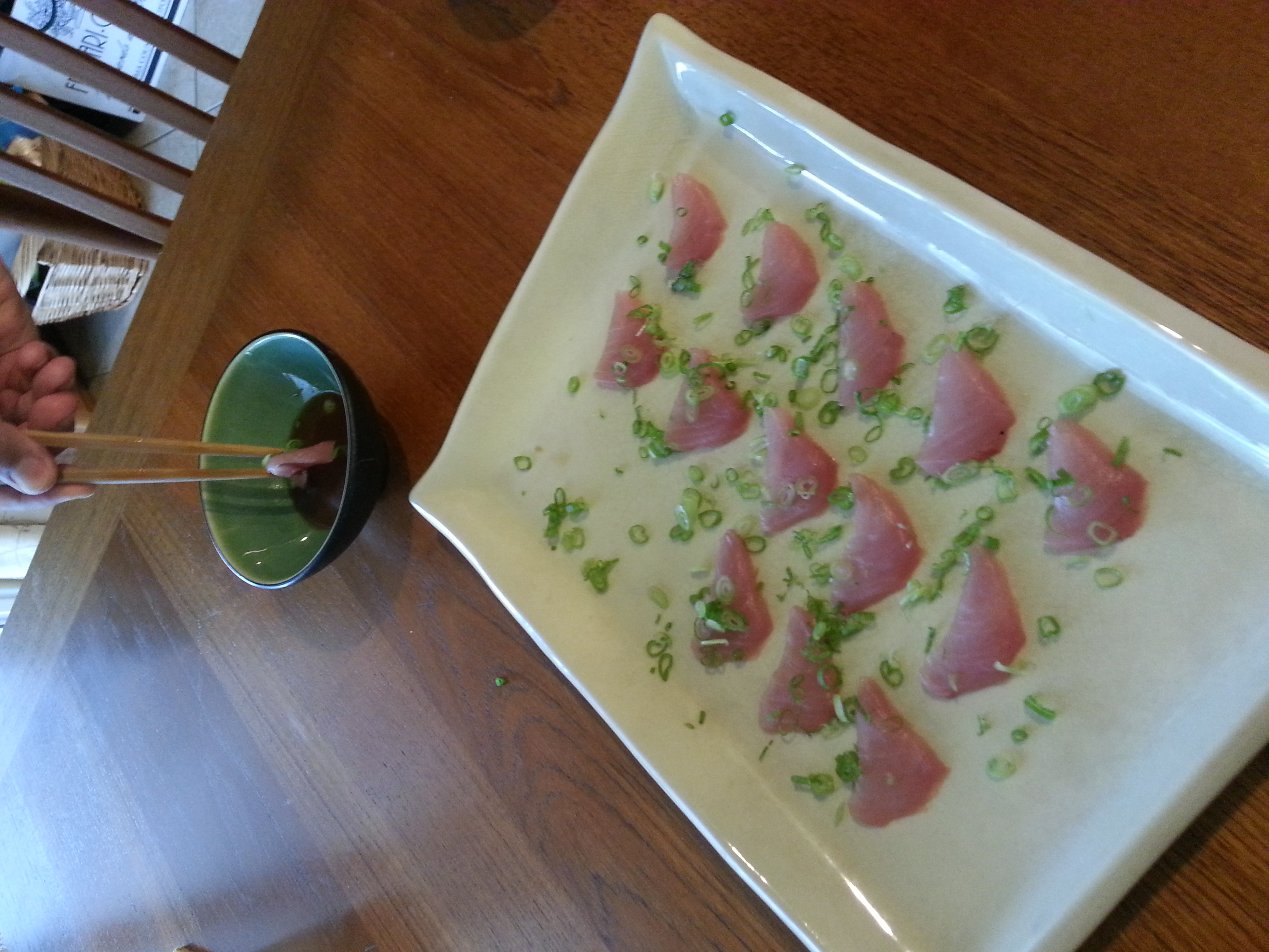 Sashimi served with scallions, ponzu & wasabi