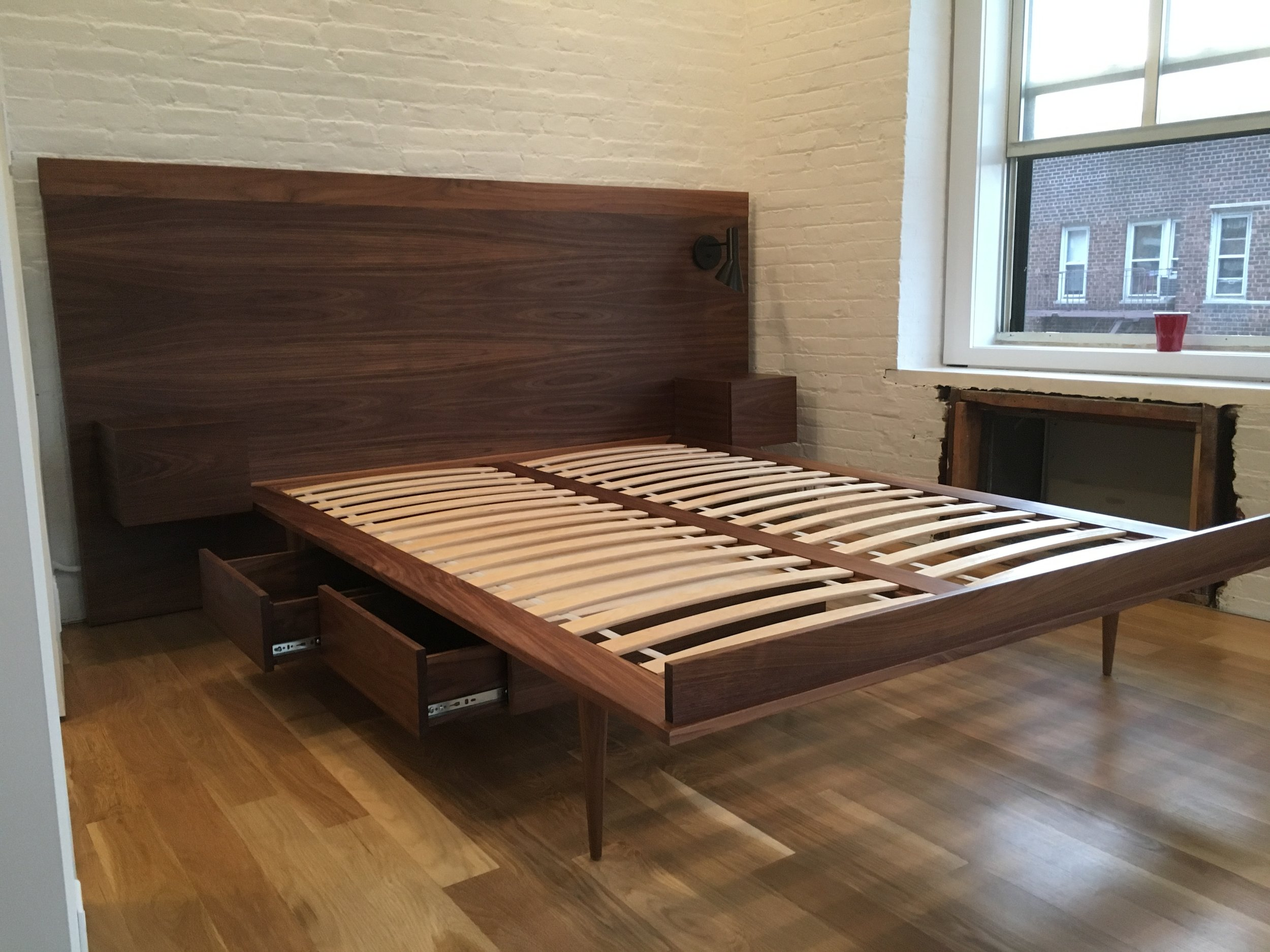 Custom bed for a New York City space. Made in walnut with floating nightstands and underbed drawers