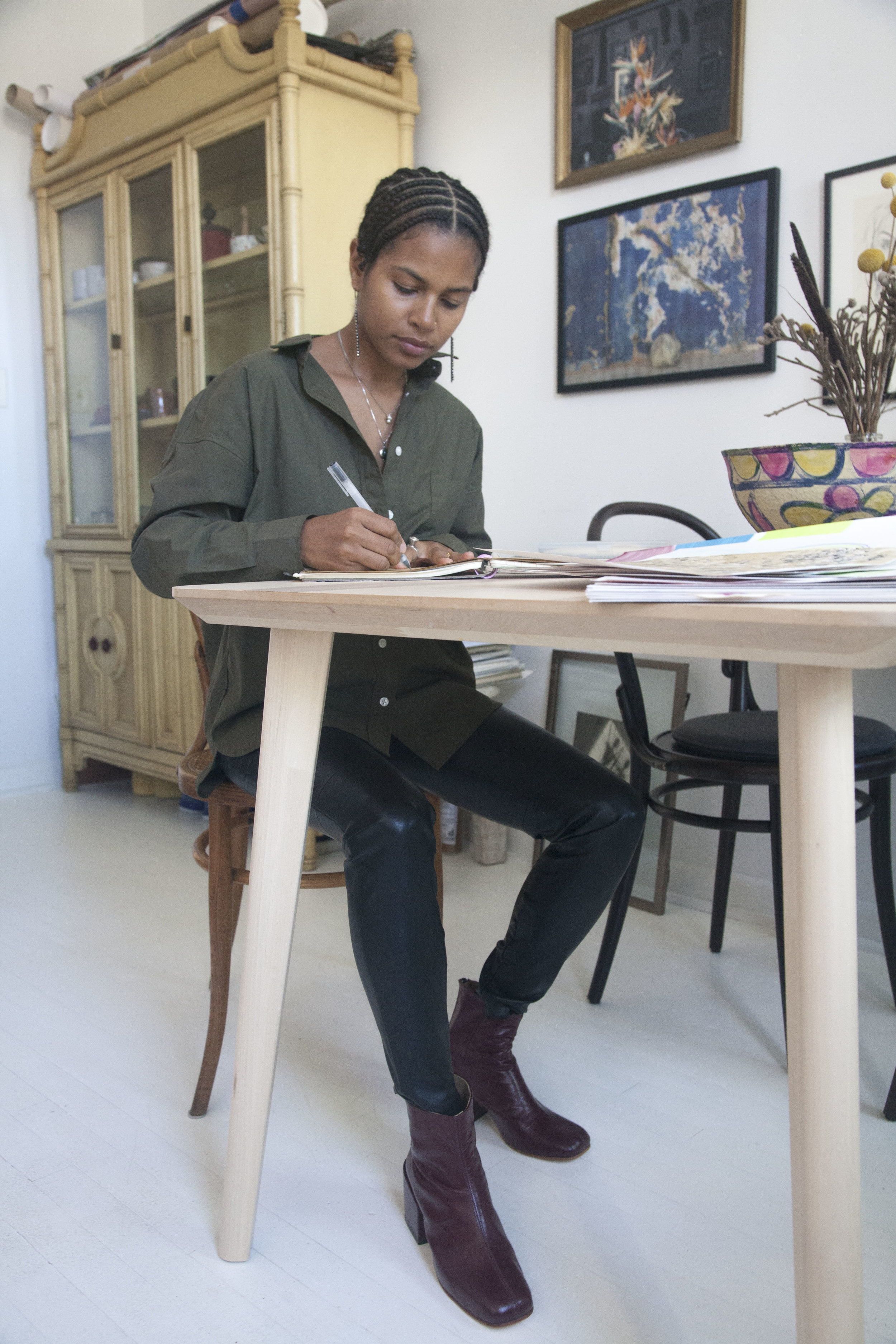 Mengly working at table wearing Beia Boot.jpg