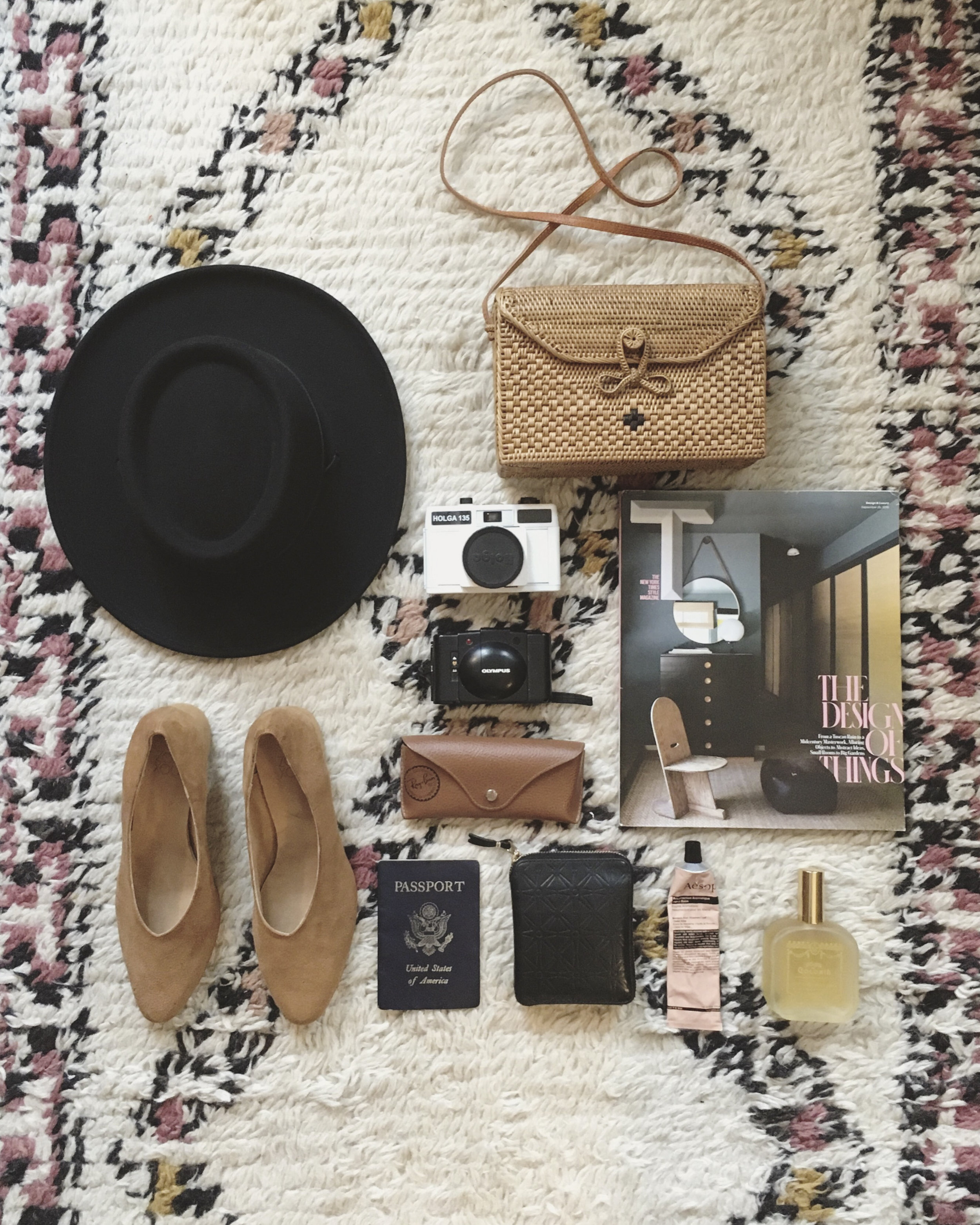Destination:Naples, Florida - Packing Essentials: 1) Tio y Tia Gambler hat for feeling like Georgia O'Keeffe, 2) Bembien Sofia bag because it's the perfect size for all my essentials and it's woven, which makes it perfect for warm-weather adventures, 3-4) two different film cameras because in my dreams I'm a legit photographer, 5) T Magazine because it's the best way to kill time on a flight, 6) Ray-Ban sunglasses because sun, 7) Aesop hand lotion: all-in-one aromatherapy and moisturizer, 8) Santa Maria Novella perfume because it's exactly how I want to smell always, 9-10)wallet and passport (self-explanatory), and 10) last but not least Zou Xou Belu pumps (In dulce de leche suede) because they go with absolutely everything I own.