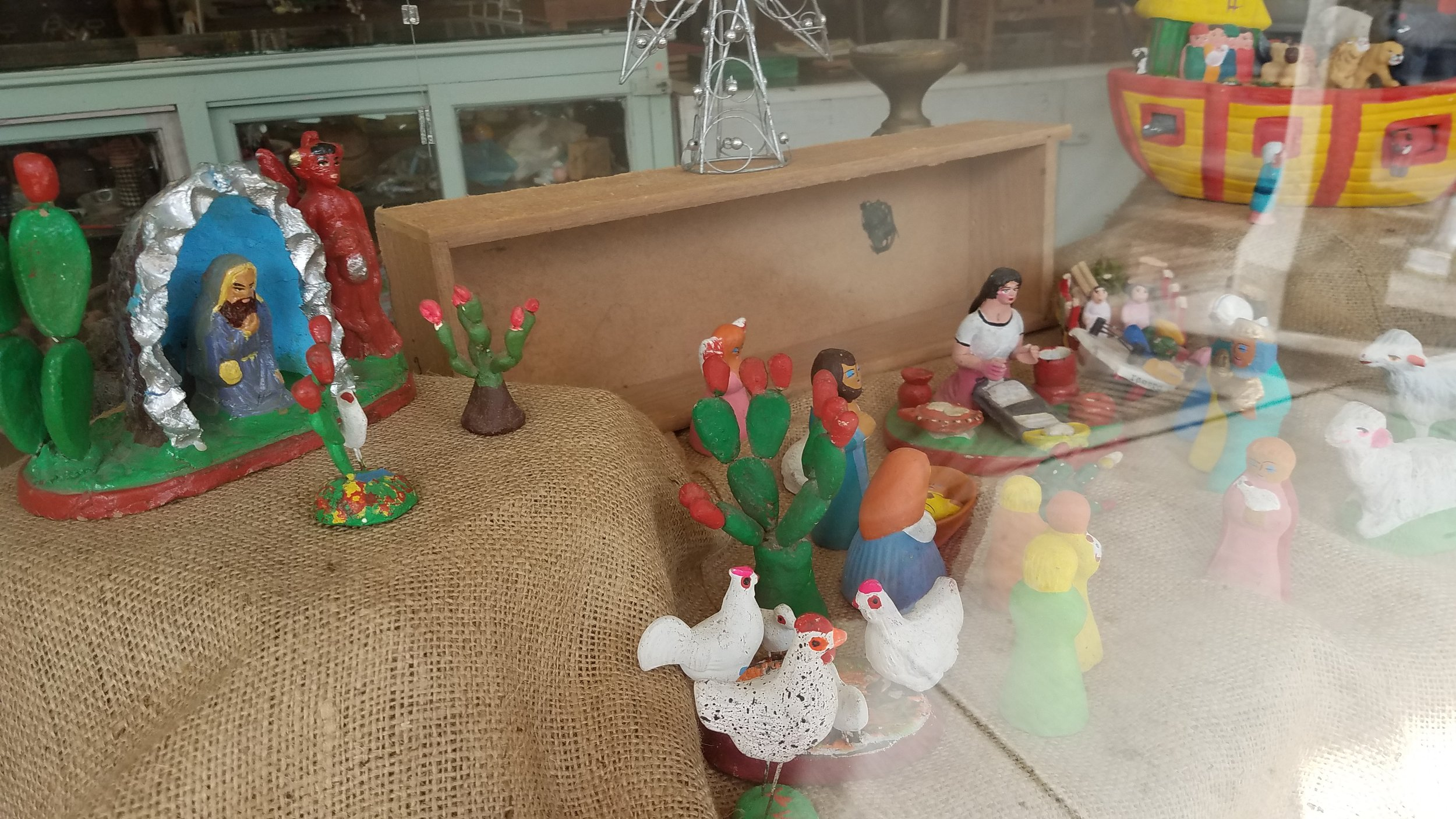 This is my wonderful Mexican folk art Nativity. It has chickens, cactus a lady working. The Devil with a praying man.