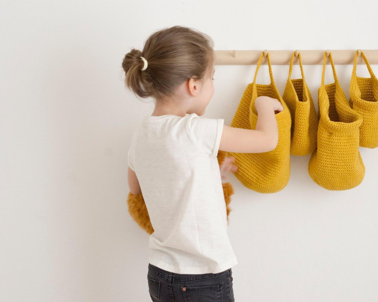 Wall Hanging Storage Basket By Rug on the Wall