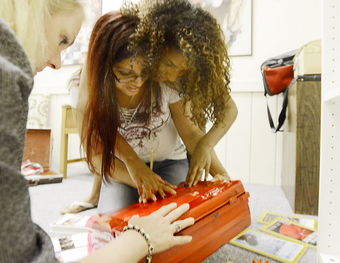 The Herald-Sun | Bernard Thomas (L. to R.) Briles Johnson, Melissa Terrell and Zaina Robinson are looking for clues that will allow them to escape, at Bull City Escape.