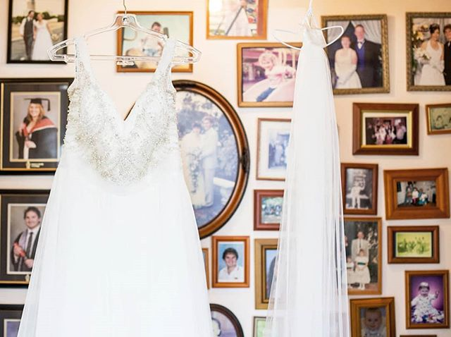 The moment I walked into Alanna's parents house and saw her dress hanging in-front of a family photo wall it was my favourite spot in the house!  So many generations of photo's, achievements and memories. My favourite being her parents wedding photo in the round frame directly behind the dress. All I hoped was that one of our photos from that day ended up pride of place on the wall there with all the other momentous occasions.  I will say though she did also have a very stunning dress 💕 . . . . . . .  #memories #love #generations #family #frozenintime #grampians #grampianswedding #weddingdress #weddingday #weddingphotography #weddings #weddingphotographer #weddinginspiration #weddingplanner #weddingideas #weddingphoto #weddingdecor #weddingparty #weddingplanning #weddingdetails #weddingtime #weddingphotos #grampianswedding #candidweddingphotographer