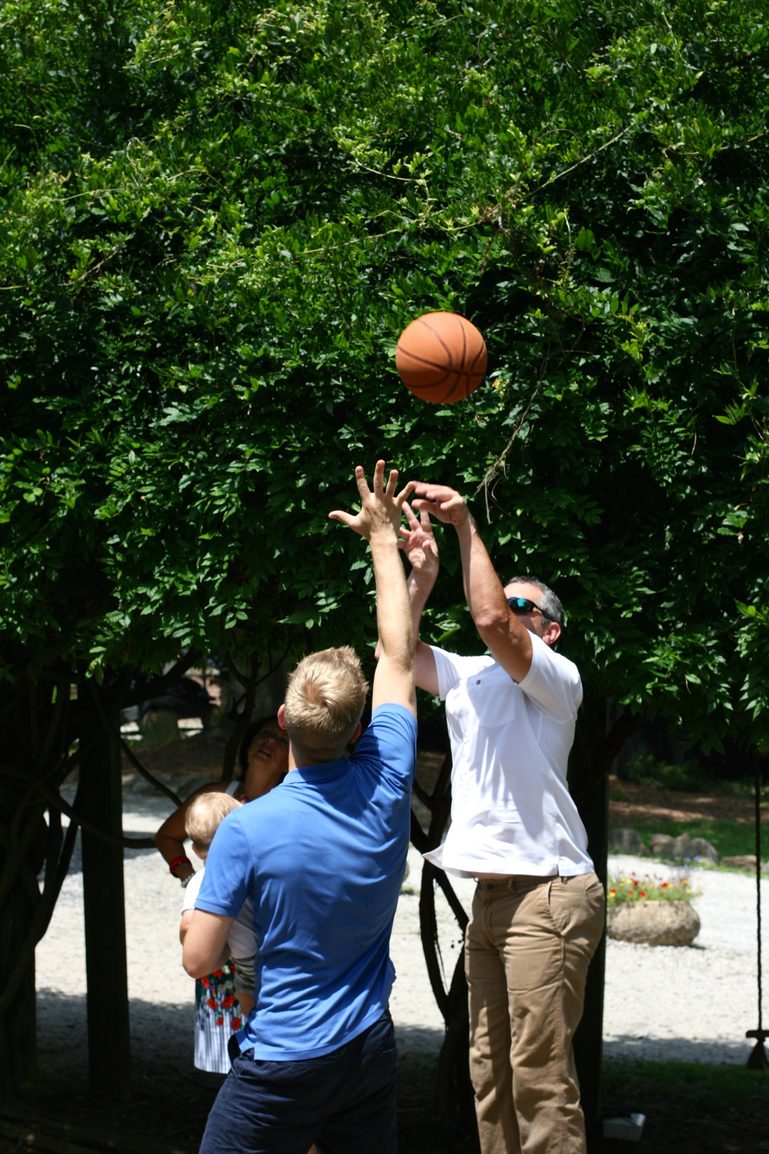 My dad, Stevie and Everett shooting hoops. The best.