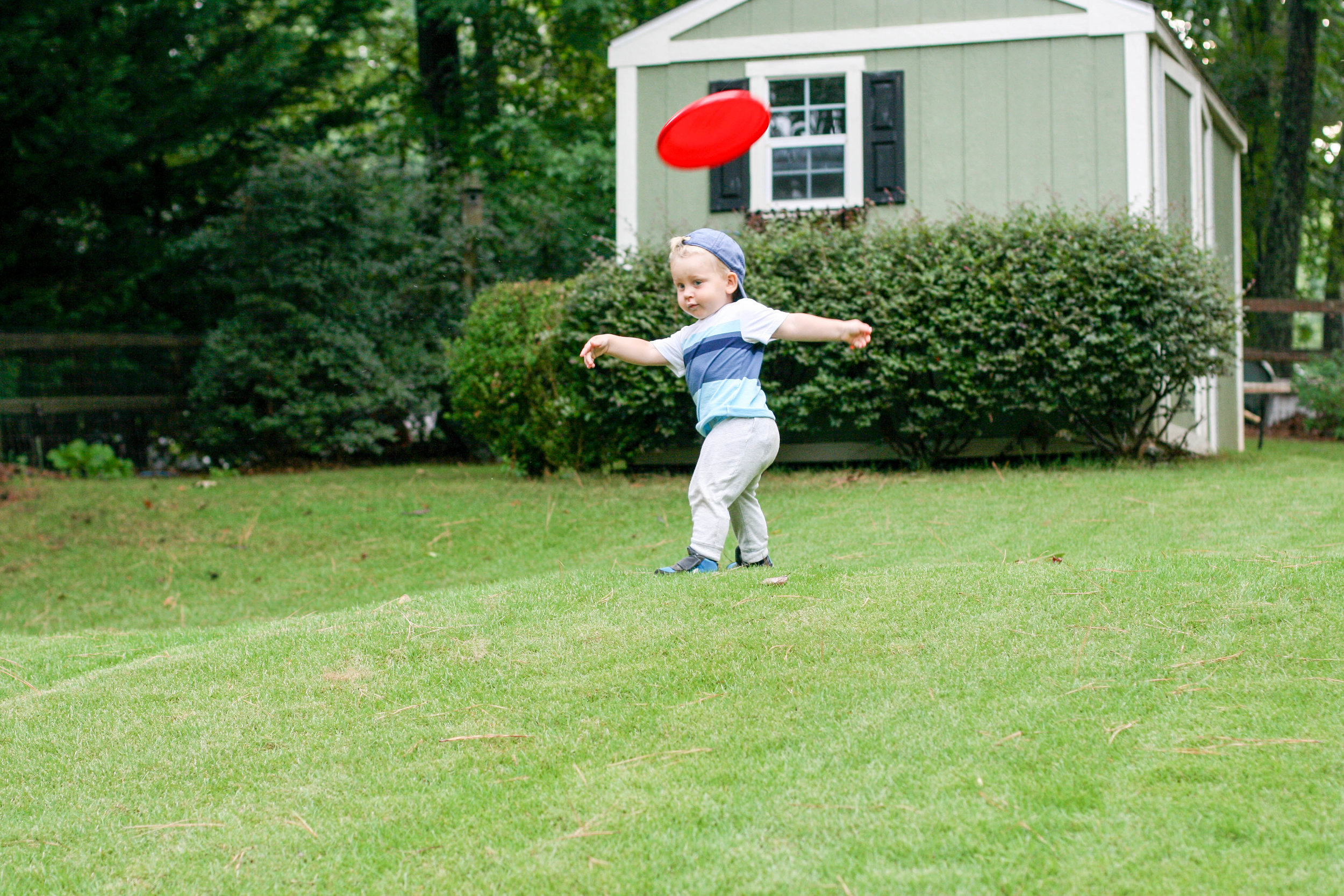 Everett learning to throw a frisbee last summer. He makes me laugh so much.