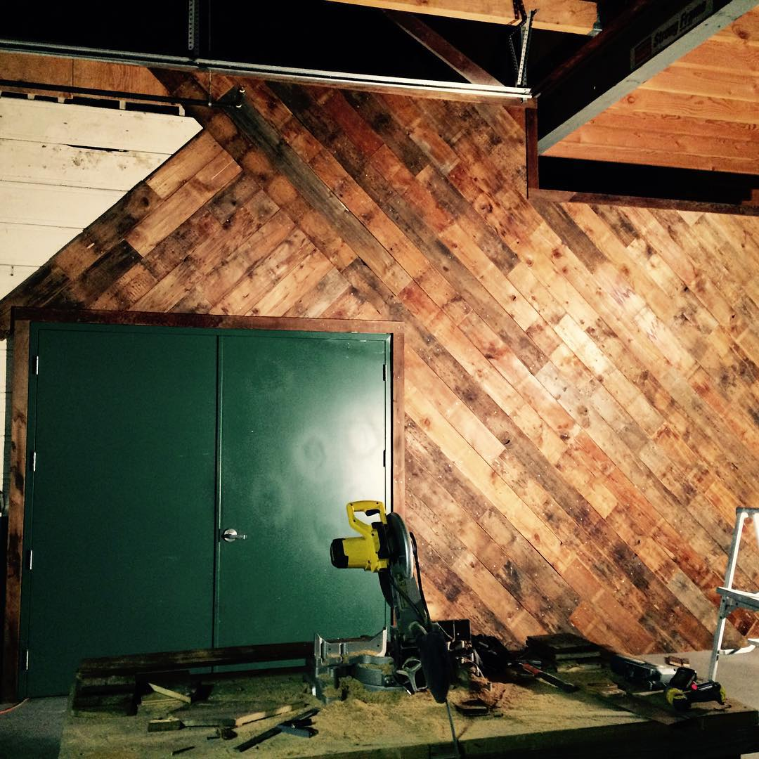 Our salvaged wood wall almost complete!