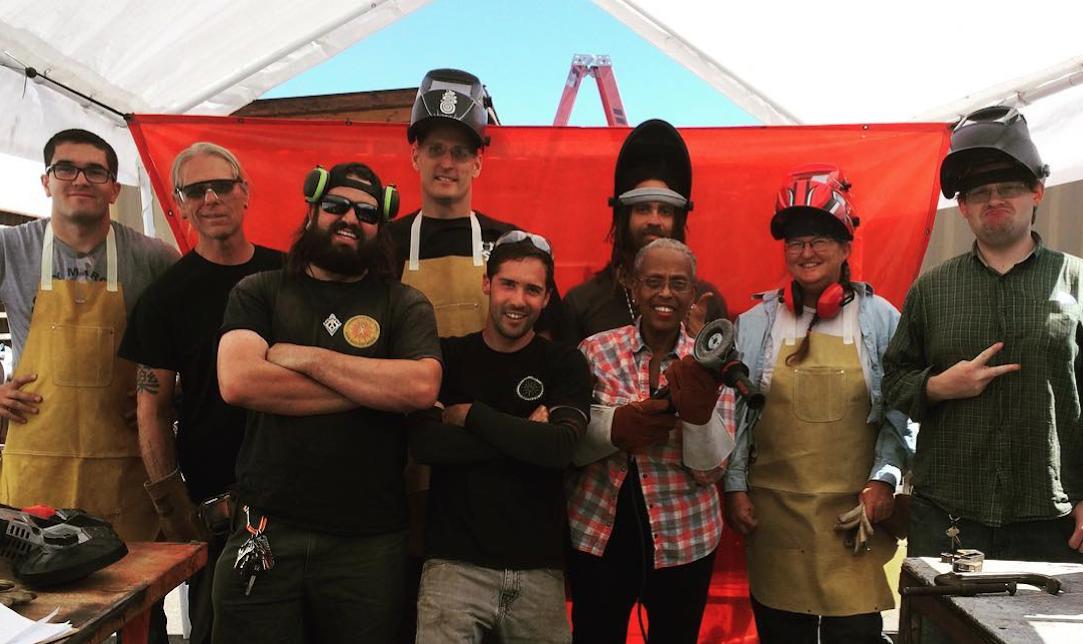 A happy crew of new metal shop graduates!
