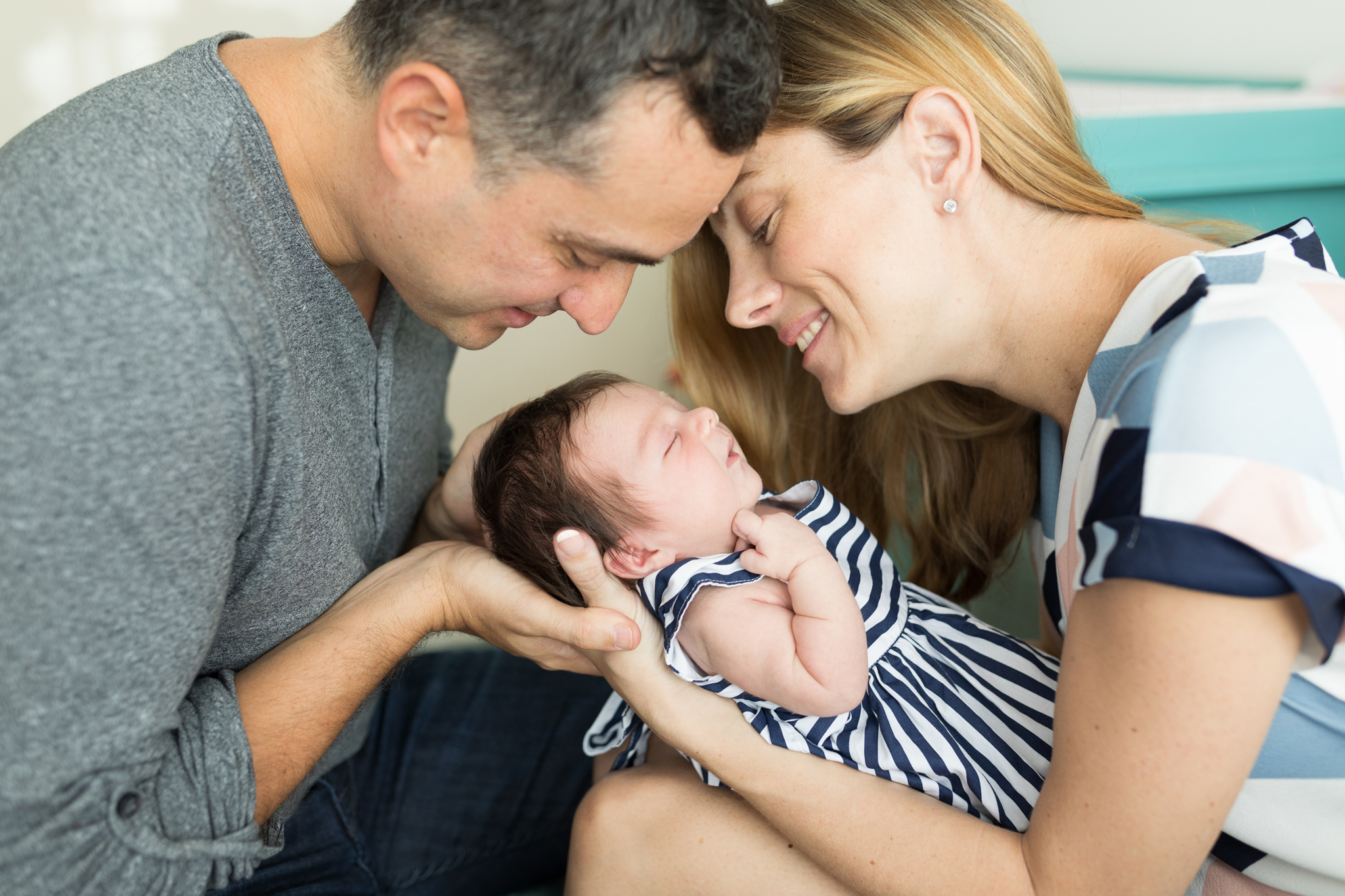 holding newborn in parents arm newborn precious in lifestyle home shoot